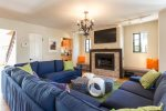 Enjoy Family and Friends in a Bright Sunset Lighting Living Room with the Entire Group