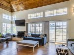Relax in Bright Open Concept Remodeled Living Room: New Bamboo Floors, Wood Vaulted Ceiling w/ Loft, Fireplace, Double Sliding Glass Doors to Ocean Breeze Patio.