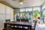 Dining area with blinds and BBQ area view