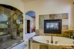 MAIN LEVEL MASTER WITH JACUZZI TUB AND WALK IN SHOWER WITH 2 SHOWER HEADS