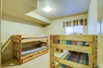 BASEMENT BEDROOM WITH 2 SETS OF BUNKS