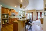 LARGE KITCHEN WITH GRANITE BAR TOP COUNTER, DUAL OVENS