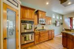 GAS RANGE, DUAL OVENS AND A WALK IN PANTRY