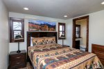 Master Bedroom with Queen Bed and private custom tiled bathroom.  Private access to the upper deck