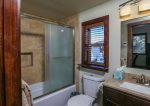 Full Guest Bathroom with heated floor and custom tile work.