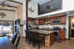 Spacious kitchen with all stainless steel appliances and beautiful granite