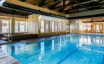 Large indoor heated pool with 2 hot tubs in the community clubhouse
