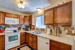 Fully functional kitchen with refridgerator, microwave, stove/oven, toaster oven and dishwasher