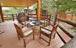 Enjoy the mountain air on the covered deck