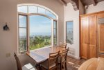 Ocean view breakfast table located in the kitchen with amazing golf course views