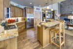 Lots of natural light show the beautiful granite counters