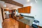 The remodeled kitchen with stainless steel appliances