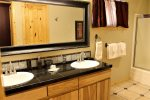 The downstairs bath features a shower/tub