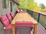 The upstairs back deck has great seating