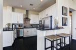 Kitchen complete with breakfast bar that seats 2, granite counter tops and stainless steel appliances
