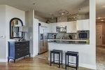 Kitchen features high end appliances, separate cooktop and stove, and breakfast bar.