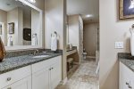 Bay Master en suite has walk-in glass shower, bathtub and dual sinks.