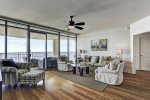 Floor to ceiling windows, access to balcony and plenty of comfortable seating