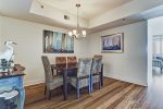 Dining room has a coastal theme and seats 6.
