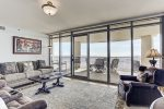 Comfortable living room features floor to ceiling windows that enjoy Gulf views.