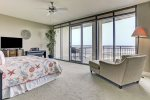 Master Bedroom has king size bed, large tv, lounge chair, and private balcony with Bay views.