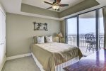Third Bedroom features a queen size bed and access to Bay balcony.