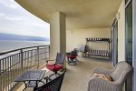 Beach balcony has ample room for sitting and watching the waves. Large electric grill is available.