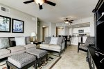Open concept living, dining and kitchen area with tile floors.