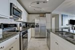 Create a culinary masterpiece in your spacious kitchen with stainless steel appliances and granite countertops