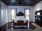 Master Bedroom with a antique 9` tall Victorian walnut queen size bed