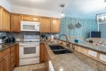 upgrade cabinets, granite countertops, microwave, oven-range, refrigerator, blender, coffee maker, cooking amenities