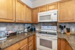 upgrade cabinets, granite countertops, microwave, oven-range, blender, coffee maker, cooking amenities