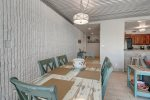 master suite, king size bed, ceiling fan, television, wicker dreser, towel hanger, glass block, lamp, decor pillows