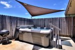 Outdoor hot tub and charcoal BBQ pit