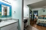 dual vanities, master bedroom suite, wood floors, blue mosaic glass mirror