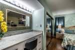large mosaic mirror, makeup area, mirrored closet, master bedroom