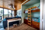 bunk beds, living area, ceiling fan, bay window wall