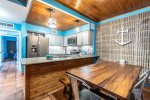 dining area and kitchen, stainless steel appliances, beach decor