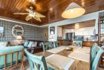 dining table with six chairs, open concept living space, palm leaf ceiling fan, wood ceiling