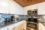 upgraded kitchen cabinets, granite counter tops, stainless appliances, kitchen amenities