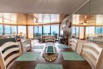 The natural light pours into a colorfully decorated vacation beach home.