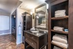 master suite vanity, tile floors, bath towels provided
