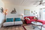 living area sectional sofa, beach wall art, end table and lamp, coffee table, ceiling fan