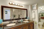 Double sink vanity and lavatory in the master bathroom