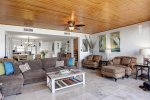 Spacious living space with sectional sleeper sofa and plush sitting chairs