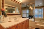 master suite bathroom with vanity and jacuzzi hot tub and shower