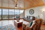 master bathroom vanity and makeup area, two mirrors, toilet, granite counters