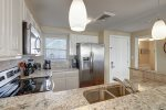 kitchen area, half bath, granite counter tops, pendant light