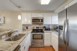 half bath, washer and dryer, mirror, vanity sink