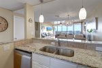 microwave, range and cook top, granite counter, appliance amenitites